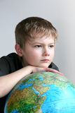 The boy with the globe. Thinks of the future royalty free stock photography