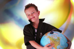 Boy with globe. Boy is holding the world in his hands Stock Photo