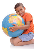 Boy with a globe. Child  holding  a globe  on the  white background