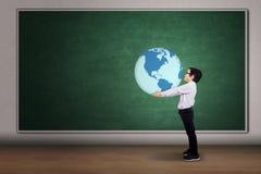 Boy with a globe Stock Photos
