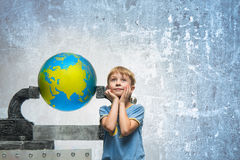 Boy with globe Stock Photography