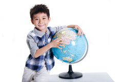 Boy with globe Stock Photos