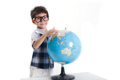 Boy with a globe Stock Photo