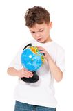 Boy with globe Royalty Free Stock Photography