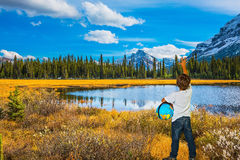 Boy with a globe under his arm Stock Photography
