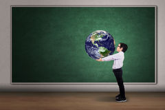 Boy with a globe of the world Royalty Free Stock Photos