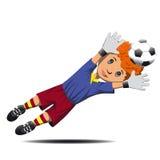 Boy goalie catching soccer ball Stock Image