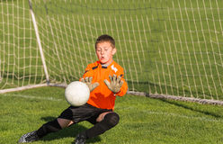 Boy goalkeeper defends Royalty Free Stock Photography