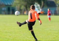 Boy goalkeeper defends the goal Stock Image
