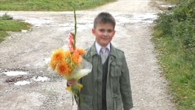 The boy goes with a bouquet stock video