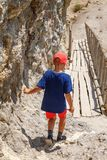 The boy goes down the stairs on a dirt road royalty free stock image