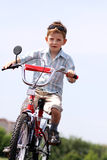 Boy goes for a drive on a bicycle Royalty Free Stock Photo