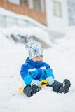 The boy goes for a drive on an snow slope. Stock Image