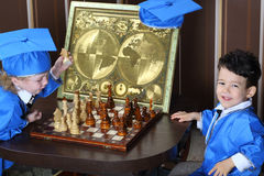 A boy goes horse during a game of chess Stock Photography