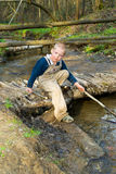Boy goes on a log Royalty Free Stock Photography
