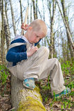 Boy goes on a log Royalty Free Stock Images