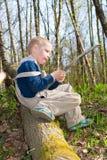 Boy goes on a log Stock Photos