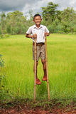 Boy goes on stilts Stock Photography
