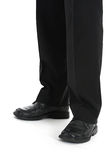 Boy goes to work. Man dressed in black trousers and black shoes over white Stock Images