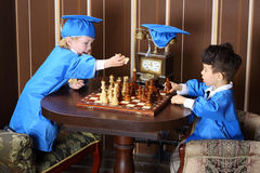 Boy goes white horse during a game of chess Royalty Free Stock Image