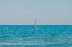 ROMA, ITALY - JULY 2017: The boy goes windsurfing on the Tyrrhenian Sea near Ostia, Italy Royalty Free Stock Photo