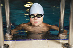 Boy in goggles at pool Royalty Free Stock Photo