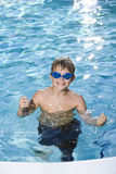 Boy with goggles in swimming pool royalty free stock image