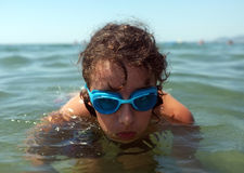 Boy with goggles in the water Stock Photos