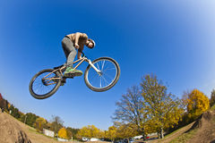 Boy going airborne with a dirt  bike Royalty Free Stock Photos
