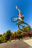 Boy going airborne with his dirt royalty free stock photography