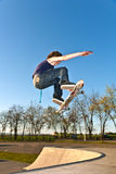 Boy going airborne with the skate Royalty Free Stock Photos