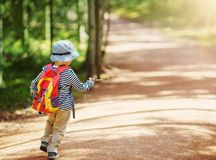 Boy going camping with backpack in nature stock image