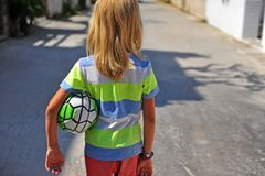 Boy going with the poor soccer ball Royalty Free Stock Images