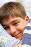 Boy going to sleep. Teenage boy going to sleep with a little smile Royalty Free Stock Photos