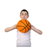 Boy going to throw a basketball ball royalty free stock image