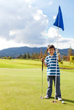 Boy with a golf flag Stock Photography
