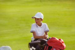 Boy playing golf stock photos