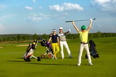The boy with his family playing golf royalty free stock image