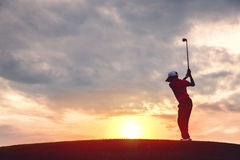 Boy golfer silhouette Stock Images