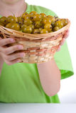 Boy with gooseberries Royalty Free Stock Image