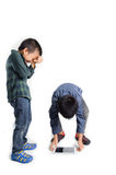 Boy grab crack table device. From the white floor royalty free stock photo
