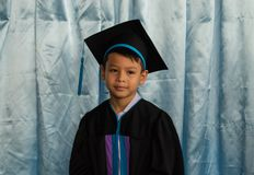 The boy graduated from kindergarten. royalty free stock photography