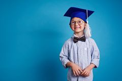 Boy in graduation hat Royalty Free Stock Images