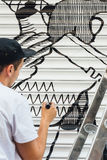 Boy graffiti, painted with marker pen, on the blind of a store Royalty Free Stock Photography