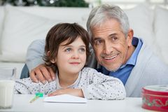 Boy And Grandfather With Envelope Smiling Royalty Free Stock Images