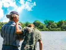 Boy and grandfather  fishing Royalty Free Stock Photos