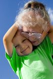 Boy with grandma. On sky stock photos