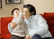Boy and grandmother Stock Photography