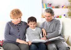 Boy with a grandmother and grandfather Stock Images
