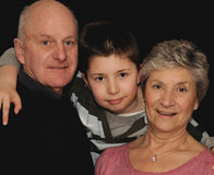 Boy with grandparents stock images